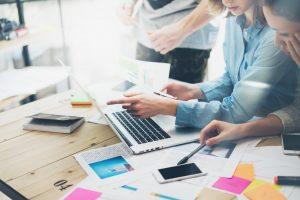 Marketing team creating advertising strategy.
